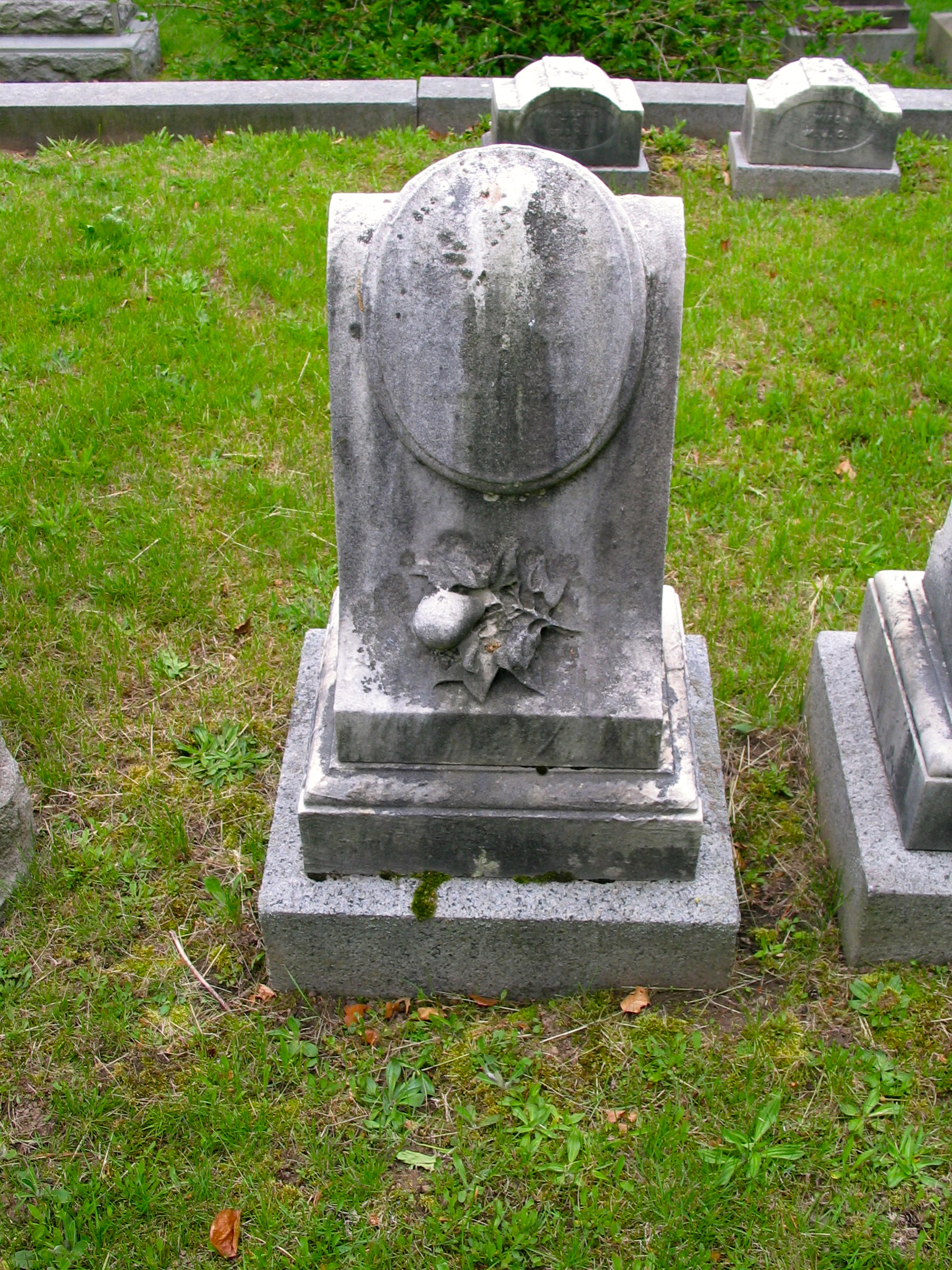The Thaddeus Clapp headstone in Forest Hills Cemetery shows his famous pear.