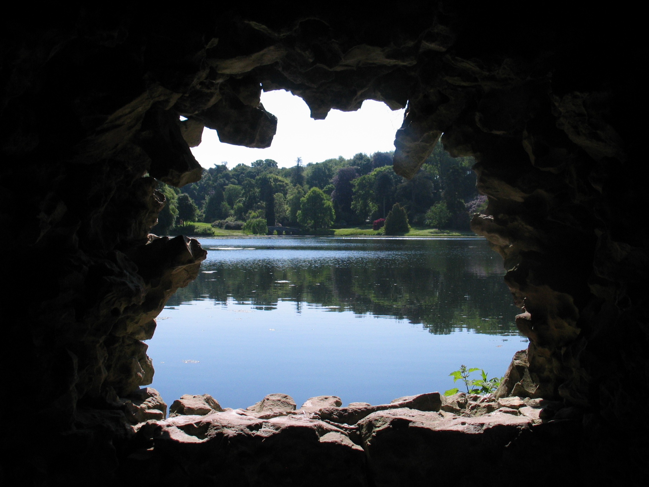 Here at England's Stourhead garden you see the lake through the grotto, a classic feature here in the landscape.